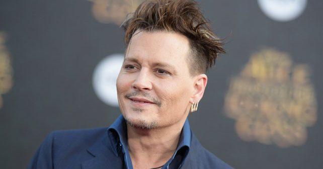 Na fotografiji je prikazan glumac, producent, muzičar: Džoni Dep (Johnny Depp)